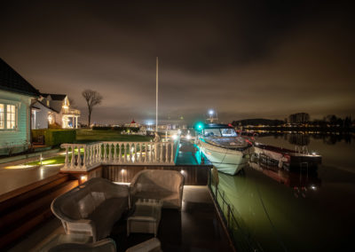 Sea front lounge by night.