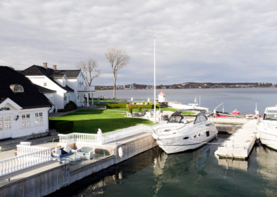 Boat docking. Sea front living.