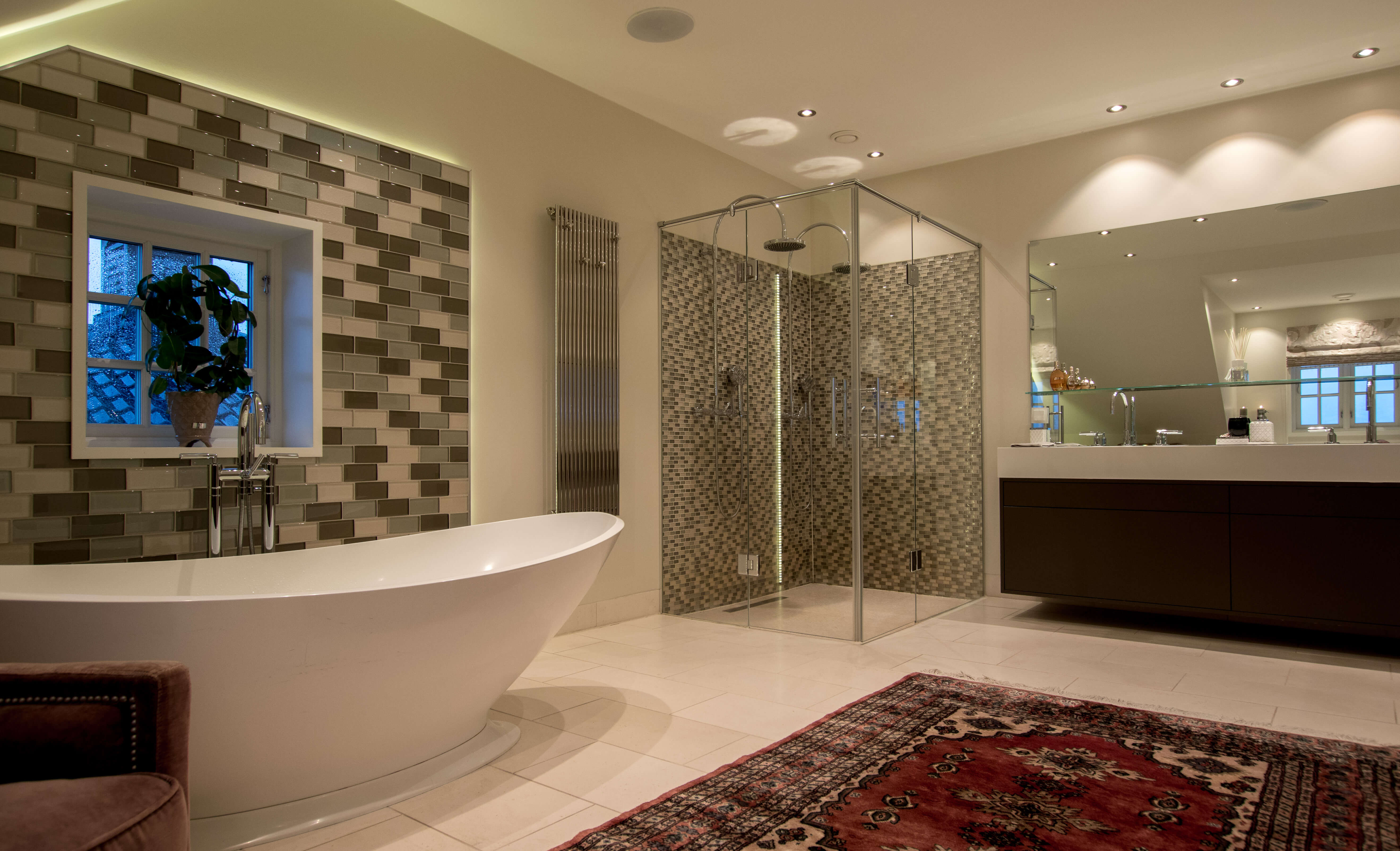Big bathroom with double shower, bathtub, double sink, downlights and all necessities.